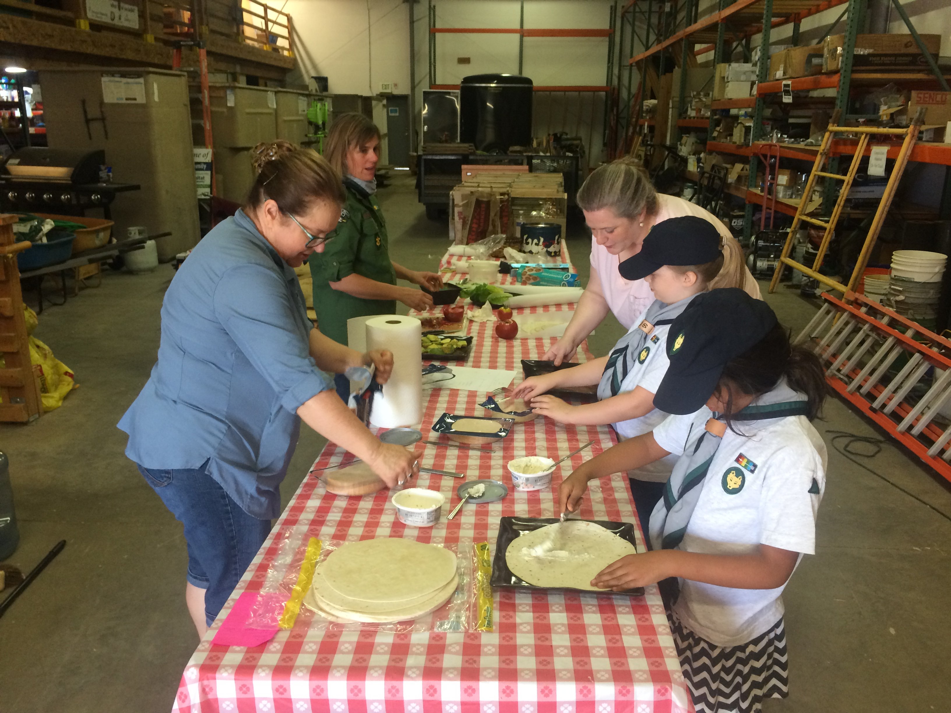 BPA Scouts making lunch for the Women Volunteers